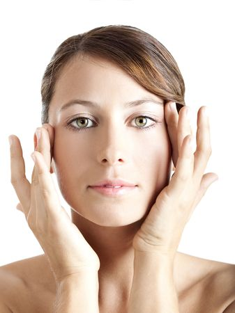 Beautiful young woman taking care of her skin face  photo