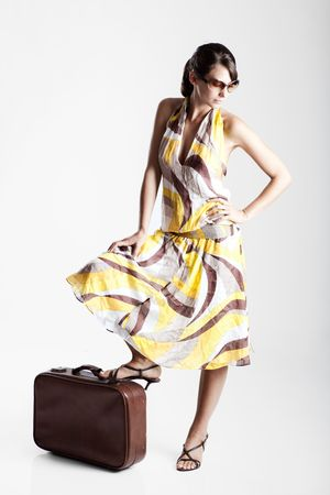 Beautiful fashion woman posing with a vintage suitcase Stock Photo - 6143451