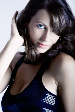 Portrait of a sexy young woman with beautiful blue eyes photo