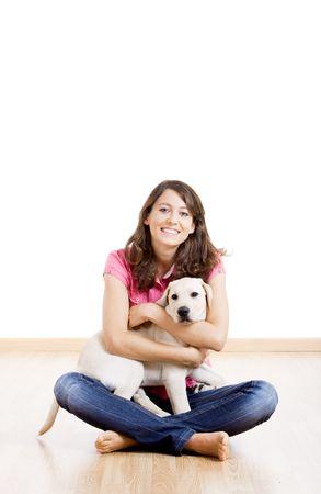 mujer perro: Joven sosteniendo un perro lindo y hermoso Foto de archivo