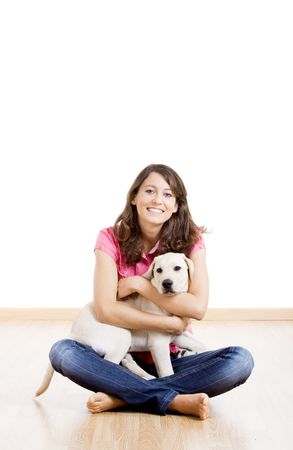Young woman holding a beautiful and cute dog Stock Photo