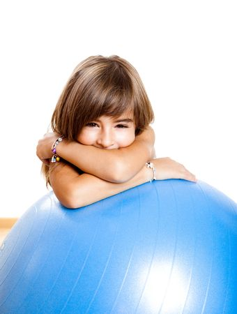 Happy little child playing with a big blue ball Stock Photo - 6191772