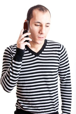 Young man talking on cellphone isolated on white background Stock Photo - 6393279