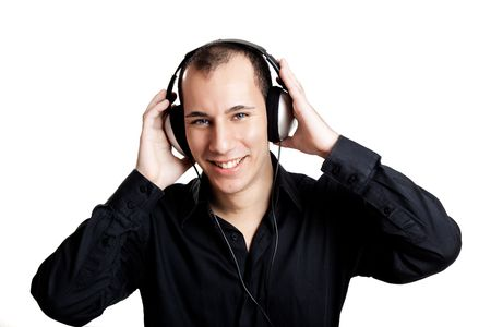 people listening: Portrait of a young man listening music with headphones