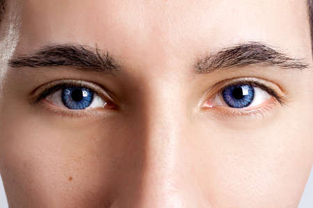 close eye: Close-up portrait of a young man with blue eyes - OBS: model use lens contact