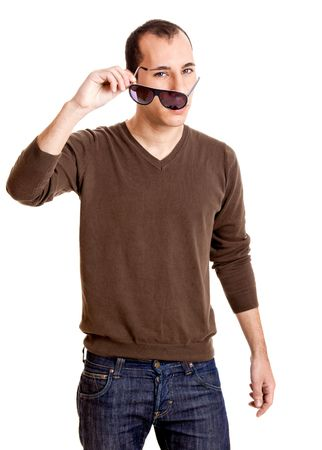 Portrait of a confident young man taking off the sunglasses, isolated on white photo