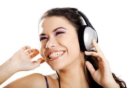 Beautiful young and happy woman listen music with headphones, isolated on white photo