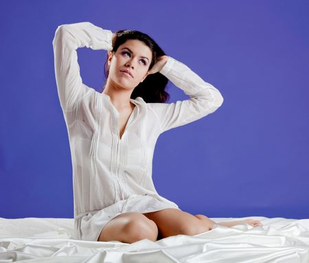 Beautiful and sexy young woman on the bed, wearing a pajama  photo