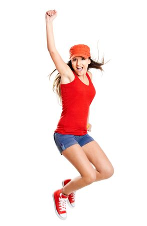 Beautiful teenage girl jumping of happiness isolated on white Stock Photo - 6534172