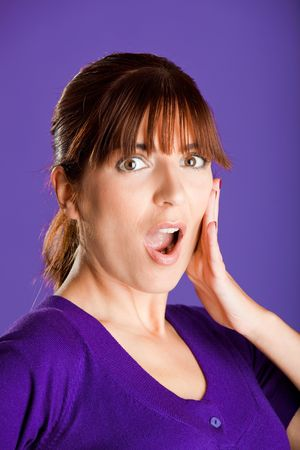 Portrait of a beautiful woman with an astonish expression, over a violet background Stock Photo - 6591449