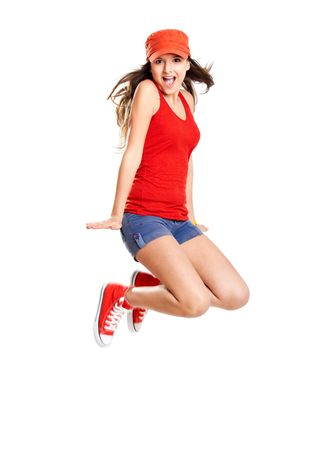 Beautiful teenage girl jumping of happiness isolated on white  photo