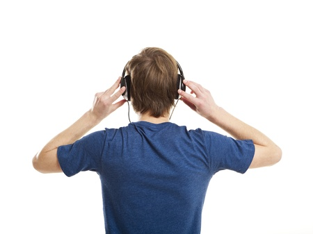 earphone: Rear view of a young man listening music with headphones, isolated on white background
