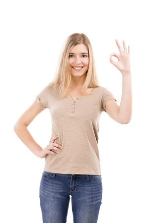 okay sign: Beautiful blonde woman doing a Okay sign with her hand, isolated over white background Stock Photo
