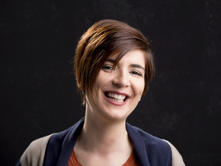 dark side: Portrait of a beautiful woman laughing and with a modern hair cut