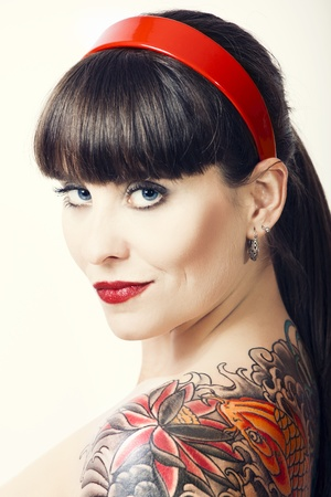 tattooed: Portrait of a beautiful young woman with a tattoos and smiling
