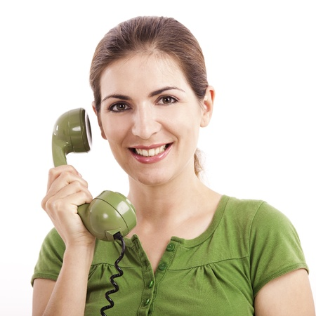 retro phone: Beautiful woman holding and talking with a vintage phone Stock Photo
