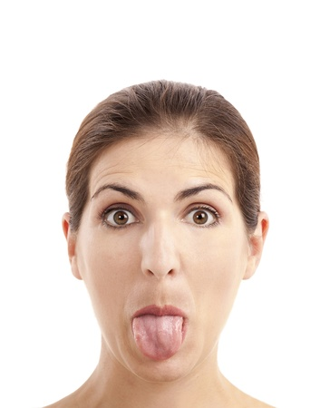 Close-up portrait of a funny woman pulling tongue out, isolated on white background photo