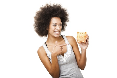 economizing: Woman holding and pointing to a piggy bank