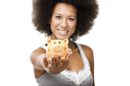 economizing: Woman holding and showing a piggy bank Stock Photo