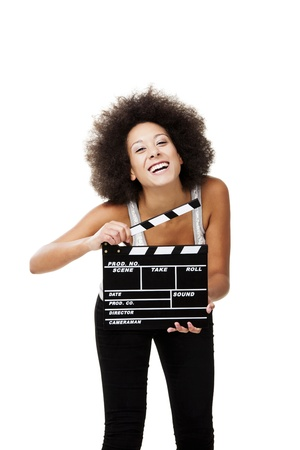 Beautiful african american woman laughing and holding a clapboard, isolated on white photo