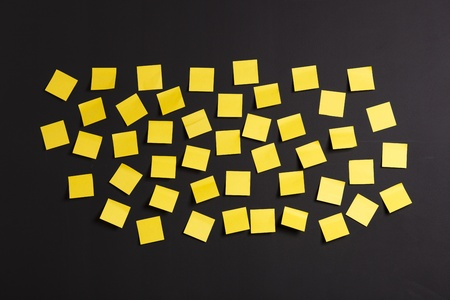 Background image of yellow notes on a black board photo
