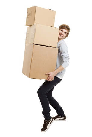 man carrying box: Portrait of a handsome young man holding card boxes, isolated on white Stock Photo