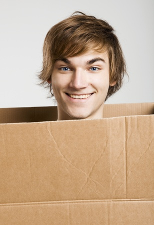 cardbox: Portrait of a handsome young man inside a cardbox