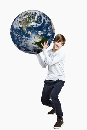 Handsome young man holding the planet earth on is hands,  isolated on white photo