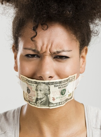 voiceless: African American woman covering her mouth with a dollar banknote, great concept for the global crises