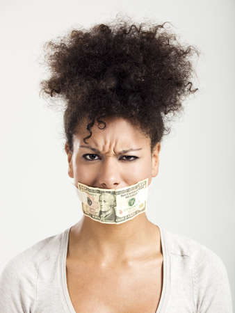 African American woman covering her mouth with a dollar banknote, great concept for the global crises photo
