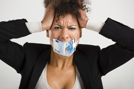 Businesswoman covering her mouth with a euro banknote, great concept for the global crises photo