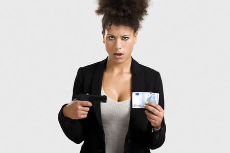 swindled: Businesswoman shooting a euro banknote, great concept for the global crises