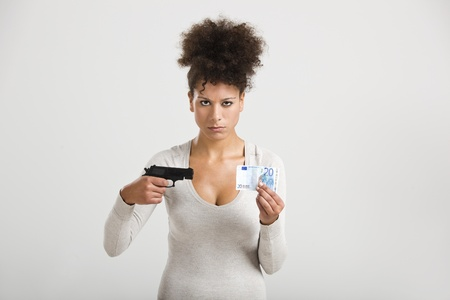 swindled: African woman shooting a euro banknote, great concept for the global crises