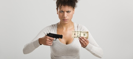 swindled: African woman shooting a US-Dollar banknote, great concept for the global crises