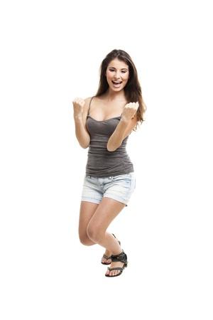 elegante: Portrait d'une belle et jeune femme heureuse après avoir remporté quelque chose, isolé sur blanc Banque d'images