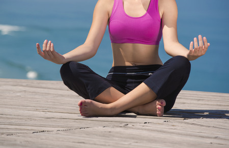 Beautiful young woman in outdoor doing yoga photo