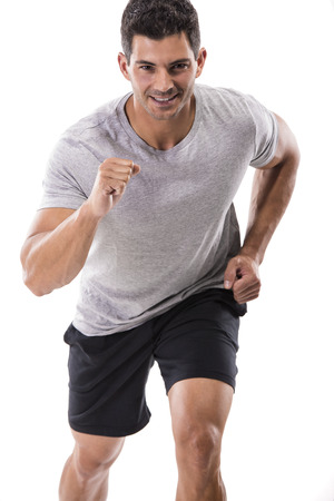 An athletic man running, isolated over a white background Stock Photo
