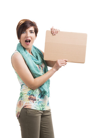 admired: Beautiful woman holding a cardboard and admired with something on it, isolated over a white background
