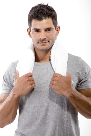 Portrait of a athletic man after doing exercises, isolated over a white background photo