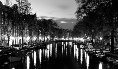 Beautiful night view of the channel in Amsterdam photo