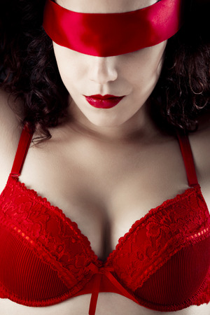 Sexy woman with a red lingerie and blindfolded photo