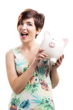 admired: Admired woman with a piggy bank, isolated over a white background Stock Photo