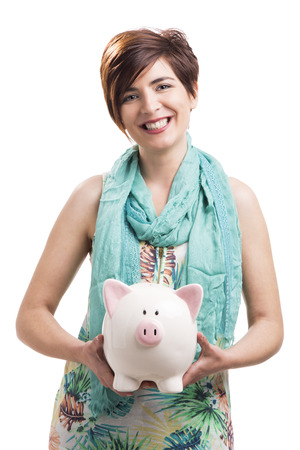 Beautiful happy woman with a piggy bank, isolated over a white background photo