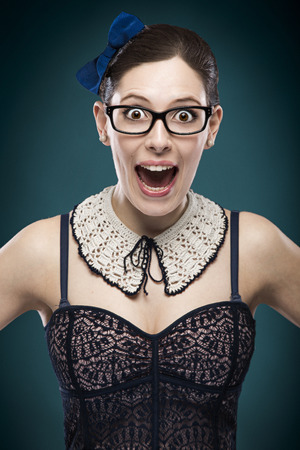 Portrait of a beautiful woman making a funny face photo
