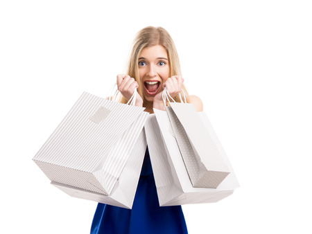 Beautiful woman with a happy face holding shopping bags, isolated on a white background photo