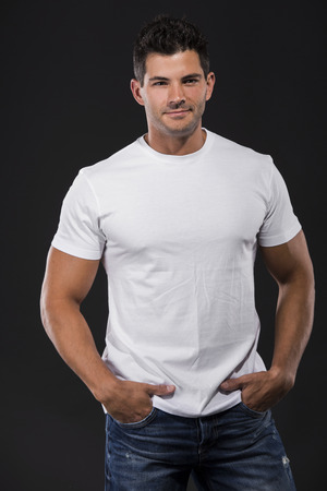 Handsome latin man standing over a white background photo