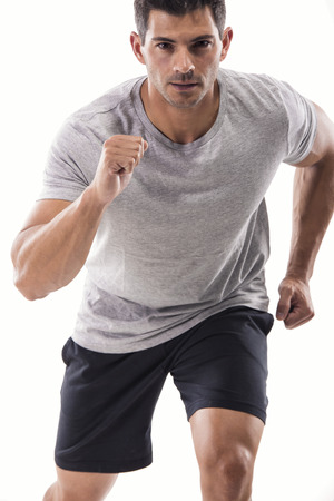 An athletic man running, isolated over a white background photo