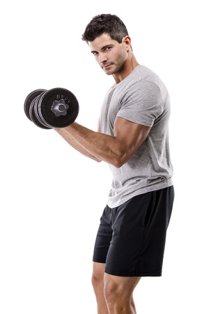 Portrait of a muscular man lifting weights, isolated over a white background Stock Photo
