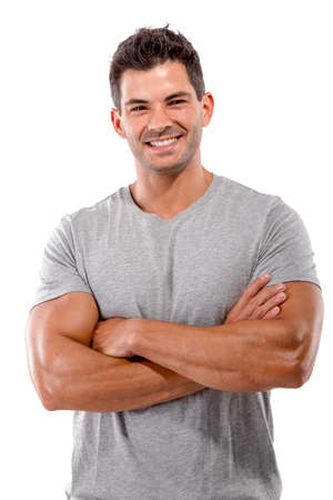 Portrait of a handsome latin man smiling with hands folded, isolated over a white background photo