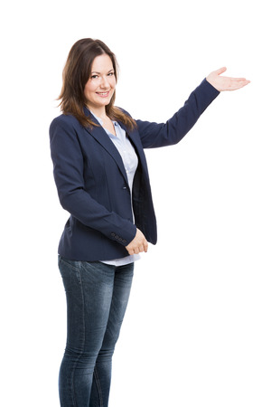 Business woman showing something with her left hand and looking to the camera, isolated over white photo